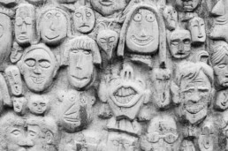 Faces sculpted on wall