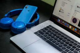 Laptop with blue phone and headset